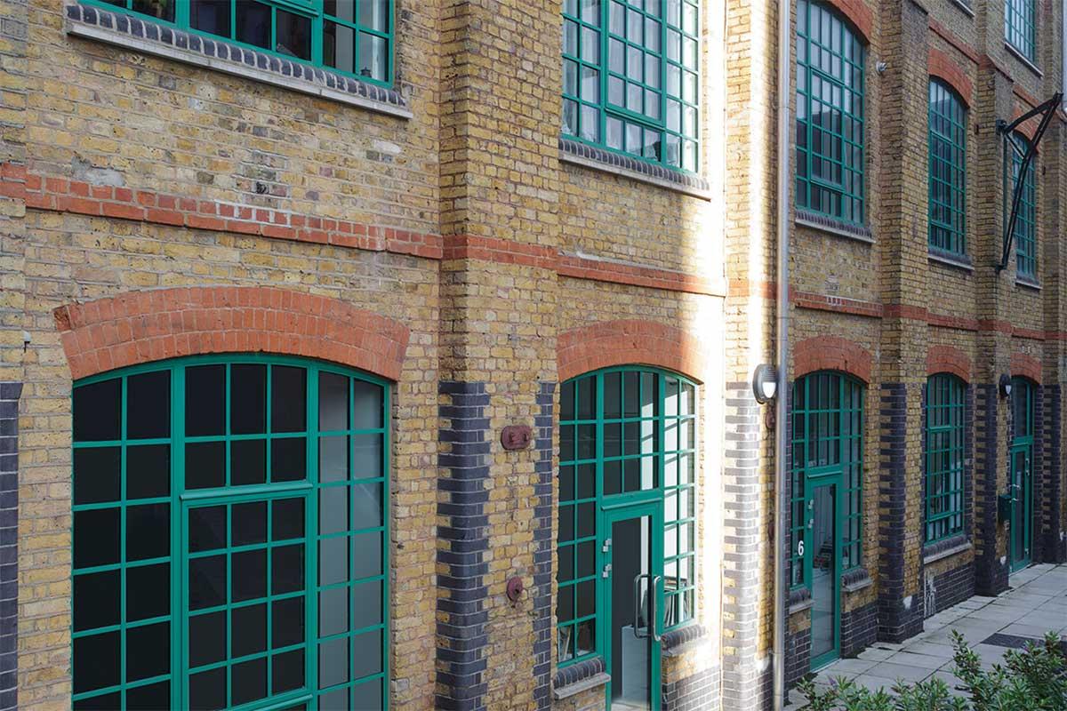 green aluminium framed windows on residential conversion
